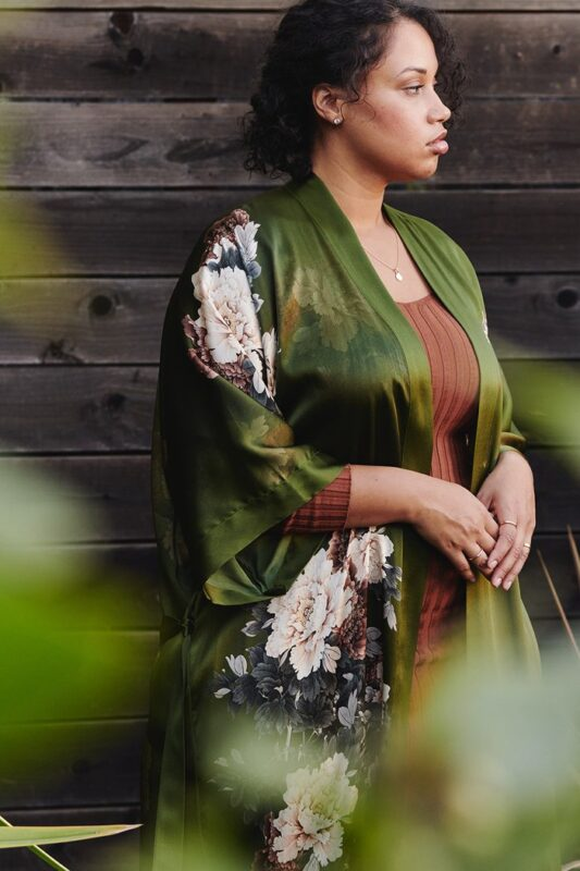 Kim + Ono robe made of green real silk with floral print, worn by plus size model with brown tank underneath